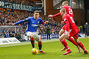 James Tavernier (C) takes on Niall McGinn of Aberdeen FC & Dean Campbell of Aberdeen FC during the William Hill Scottish Cup quarter final replay match between Rangers and Aberdeen at Ibrox, Glasgow, Scotland on 12 March 2019.