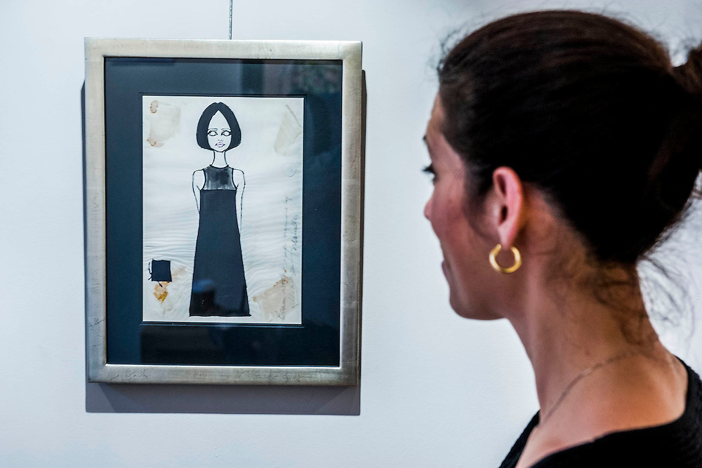 Barbara Hulanicki (1936 - ), Original Fashion Design BIBA - Black Shift Dress<br /> Abingdon Road 'Biba's Postal Boutique', 1964. Drawing on Style: Four Decades of Elegance - an exhibition of original vintage fashion illustrations from Post War 1940s through to the 1970s organized by GRAY M.C.A, leading specialists in Fashion Illustration.  It includes more than 40 original works by some of the leading illustrators of the time from Britain, Europe and America including René Bouché, René Gruau and Carl Erickson for publications including Vogue as well as advertising work for L'Oreal and other famous names in Haute Couture.  There are also a selection of original designs by designers including Dior, Biba & Zandra Rhodes. Coinciding with London Fashion Week, the exhibition runs from Thursday 11th - Tuesday 16th September 2014 with prices from £300-£10,000. Gallery 8, St James's, London. 10 Sept 2014. Guy Bell, 07771 786236, guy@gbphotos.com