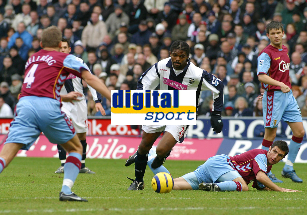 Photo: Dave Linney.<br />West Bromwich Albion v Aston Villa. The Barclays Premiership. 02/01/2006.West Brom's Kan(C) finds a way through the Villa defence. Olof Mellburg(L)  & Mark Delaney(R)