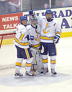 LSSU goaltender Brian Mahoney-Wilson (center) celebrates the Lakers 3 - 2 win over the OSU Buckeyes with teammates Steven Kaunisto (left) and Simon Gysbers (right) at the end of the teams Friday night game at Taffy Abel Arena.