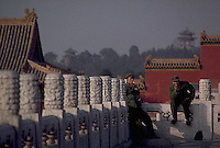 December 1983, Beijing, China --- Chinese soldiers take a cigarette break at the Forbidden City, Beijing, China. --- Image by © Owen Franken/CORBIS