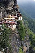 "Paro, Bhutan. The monastery of Taktshang. Taktshang is the most renowned  amongst the Buddhist monasteries of Bhutan. It is located on a cliff at 3.120 meters height, approximately 700 meters above the valley of Paro. The name means ""Nest of the tiger""."