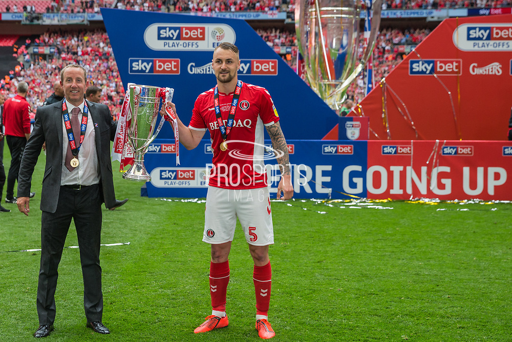 Lee Bowyer, Manager of Charlton Athletic FC & Patrick Bauer (Capt) (Charlton) celebrating their win & promotion to the Championship League during the EFL Sky Bet League 1 play off final match between Charlton Athletic and Sunderland at Wembley Stadium, London, England on 26 May 2019.