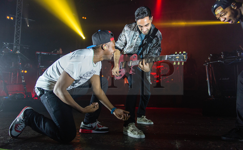 © Licensed to London News Pictures. 15/02/2014. London, UK.   Rudimental performing live at Brixton Academy. In this picture - Amir Amor (centre),DJ Locksmith (right).  Rudimental are an English electronic music quartet consisting of members Piers Agget,Kesi Dryden, Amir Amor,DJ Locksmith.    Photo credit : Richard Isaac/LNP