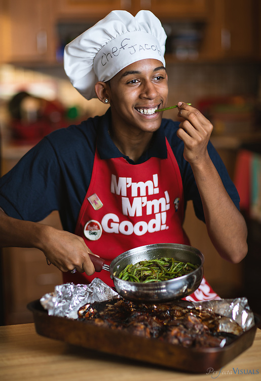 Jacob McPhaul inherited his love of cooking from his mother, Keshia. He'll graduate from the Middle College at A&amp;T and plans to enroll at Johnson &amp; Wales in Charlotte in the fall to become a cook.<br /> <br /> Photographed, Thursday, May 17, 2018, in Greensboro, N.C. JERRY WOLFORD and SCOTT MUTHERSBAUGH / Perfecta Visuals