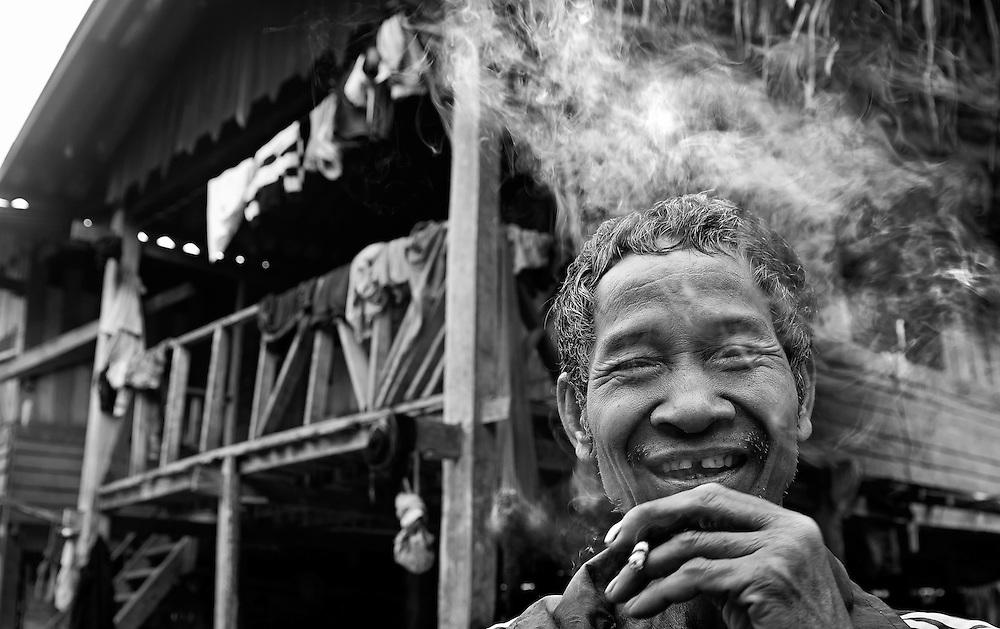 A man in a village near the Nam Tha (river), Laos.