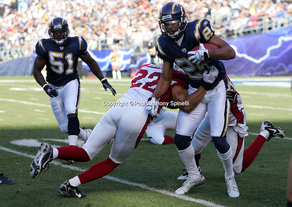 SAN DIEGO - DECEMBER 31:  Cletis Gordon #24 of the San Diego Chargers tries to avoid a tackle by Matt Ware #22 of the Arizona Cardinals at Qualcomm Stadium on December 31, 2006 in San Diego, California. The Chargers defeated the Cardinals 27-20 to secure the number one seed in the AFC playoffs. ©Paul Anthony Spinelli *** Local Caption *** Cletis Gordon;Matt Ware