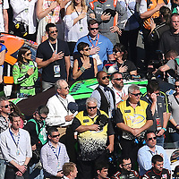 Danica Patrick and boyfriend Aaron Rodgers stand beside the GoDaddy Chevrolet for the flyover during driver introductions for the 60th Annual NASCAR Daytona 500 auto race at Daytona International Speedway on Sunday, February 18, 2018 in Daytona Beach, Florida.  (Alex Menendez via AP)