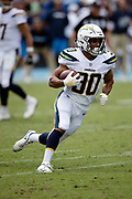 Los Angeles Chargers running back Austin Ekeler (30) runs for a second quarter gain of 7 yards to the San Francisco 49ers 32 yard line during the NFL week 4 regular season football game against the San Francisco 49ers on Sunday, Sept. 30, 2018 in Carson, Calif. The Chargers won the game 29-27. (©Paul Anthony Spinelli)