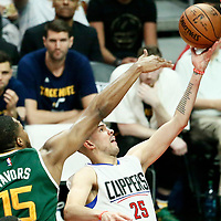 30 April 2017: LA Clippers guard Austin Rivers (25) goes for the layup past Utah Jazz forward Derrick Favors (15) during the Utah Jazz 104-91 victory over the Los Angeles Clippers, during game 7 of the first round of the Western Conference playoffs, at the Staples Center, Los Angeles, California, USA.
