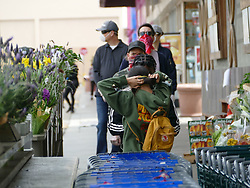 Shoppers waiting to go in Whole Foods, practice social distancing and wear face masks while using Britney Spears Experience now closed as a back drop. 15 Apr 2020 Pictured: Whole Foods Shoppers COVID19 Social Distancing. Photo credit: KAT / MEGA TheMegaAgency.com +1 888 505 6342