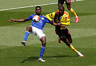 Wilfred Ndidi of Leicester City challenged by Abdoulaye Doucoure of Watford during the Premier League match at Vicarage Road, Watford. Picture date: 20th June 2020. Picture credit should read: Darren Staples/Sportimage