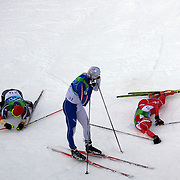 Winter Olympics, Vancouver, 2010.Dario Cologna, Switzerland, winning Gold (right) with other competitors  after the finish ,Rene Sommerfeldt, Germany (left) and Giorgio Di Centa, Italy, at the  in the Men's 15km Cross Country Skiing event at The Whistler Olympic Park, Whistler, during the Vancouver Winter Olympics. 14th February 2010. Photo Tim Clayton