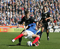 Photo: Lee Earle.<br /> Portsmouth v Blackburn Rovers. The Barclays Premiership. 08/04/2006. Pompey's Andres D'Alessandro (F) clashes with David Bentley.