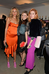 Left to right, PHOEBE COLLINGS JAMES, AMBER ATHERTON and PAULA GOLDSTEIN at the launch of The Lulu Perspective to celebrate 25 years of Lulu Guinness held at 74a Newman Street, London on 13th September 2014.