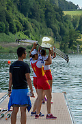 Lucerne, SWITZERLAND, 12th July 2018, Friday  FISA World Cup series, No.3, Lake Rotsee, Lucerne,  CHN W4X, placing boat on the water, watched by Coach, Photographer Karon PHILLIPS