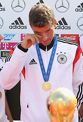 15.07.2014, Flughafen Tegel, Berlin, GER, FIFA WM, Empfang der Weltmeister in Deutschland, Finale, im Bild Thomas Mueller (GER) mit dem WM-Pokal // during Celebration of Team Germany for Champion of the FIFA Worldcup Brazil 2014 at the Flughafen Tegel in Berlin, Germany on 2014/07/15. EXPA Pictures © 2014, PhotoCredit: EXPA/ Eibner-Pressefoto/ Eibner Pressefoto / pool<br /> <br /> *****ATTENTION - OUT of GER*****