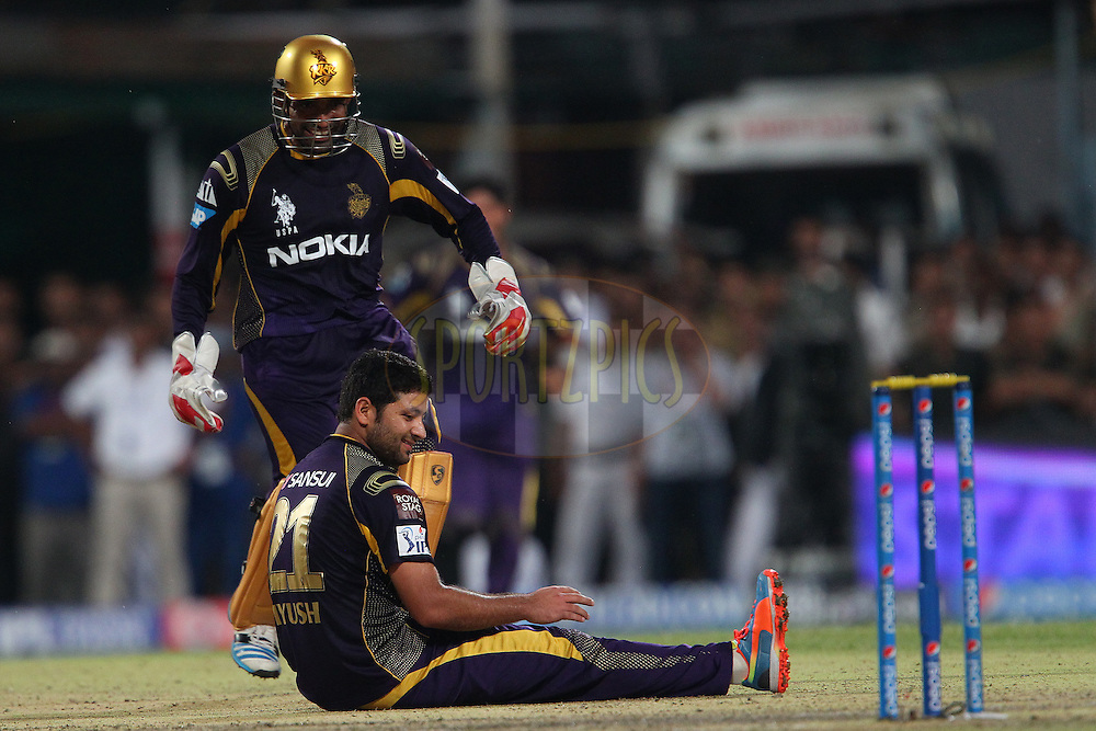 Robin Uthappa of the Kolkata Knight Riders and Piyush Chawla of the Kolkata Knight Riders celebrates the wicket of David Miller of the Kings X1 Punjab during the first qualifier match (QF1) of the Pepsi Indian Premier League Season 2014 between the Kings XI Punjab and the Kolkata Knight Riders held at the Eden Gardens Cricket Stadium, Kolkata, India on the 28th May  2014<br /> <br /> Photo by Ron Gaunt / IPL / SPORTZPICS<br /> <br /> <br /> <br /> Image use subject to terms and conditions which can be found here:  http://sportzpics.photoshelter.com/gallery/Pepsi-IPL-Image-terms-and-conditions/G00004VW1IVJ.gB0/C0000TScjhBM6ikg