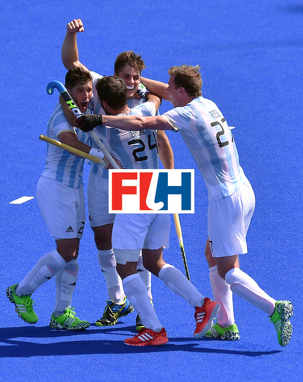Argentina's Gonzalo Peillat (C) celebrates his third goal with teammates during the men's semifinal field hockey Argentina vs Germany match of the Rio 2016 Olympics Games at the Olympic Hockey Centre in Rio de Janeiro on August 16, 2016. / AFP / Carl DE SOUZA        (Photo credit should read CARL DE SOUZA/AFP/Getty Images)