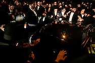Mourners of the the of Grand Rabbi Moses Teitelbaum, worldwide spiritual leader of tens of thousands of members of the ultra-Orthodox Jewish sect, Satmar Hassidim, fill the street  durring his funeral procession in Brooklyn, New York after he died in New York City at the age of 91 Monday 24 April 2006.
