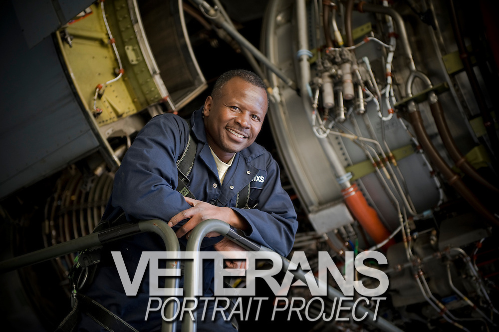 Technical Sgt. Gerald Forrest stands next the a C-17 Globemaster aircraft under maintenance by the 315th Metal Machine Shop at Charleston Charleston Air Force Base, S.C., on Oct. 30, 2008.