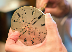 "© Licensed to London News Pictures. 23/10/2014. Guildford, UK. Michael Tooke changes the time on a marine chronometer mechanism from the 1860's made by Parkinson and Frodsham. As British Summer Time comes to an end, staff at Horological Workshops start the task of changing the 100's of clocks at their store in Guildford, Surrey, UK. Michael Tooke who has owned the store for over 40 years and worked in the clock business all his life said. ""at this time of year we get a lot of people who bring clocks in for repair after they have changed the time incorrectly by winding back the hands manually"". Clocks change on Sunday morning 26th October. Photo credit : Stephen Simpson/LNP"