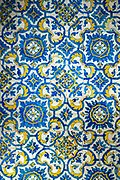 Azulejos Portuguese blue and white and yellow wall tiles in traditional pattern in Aveiro, Portugal