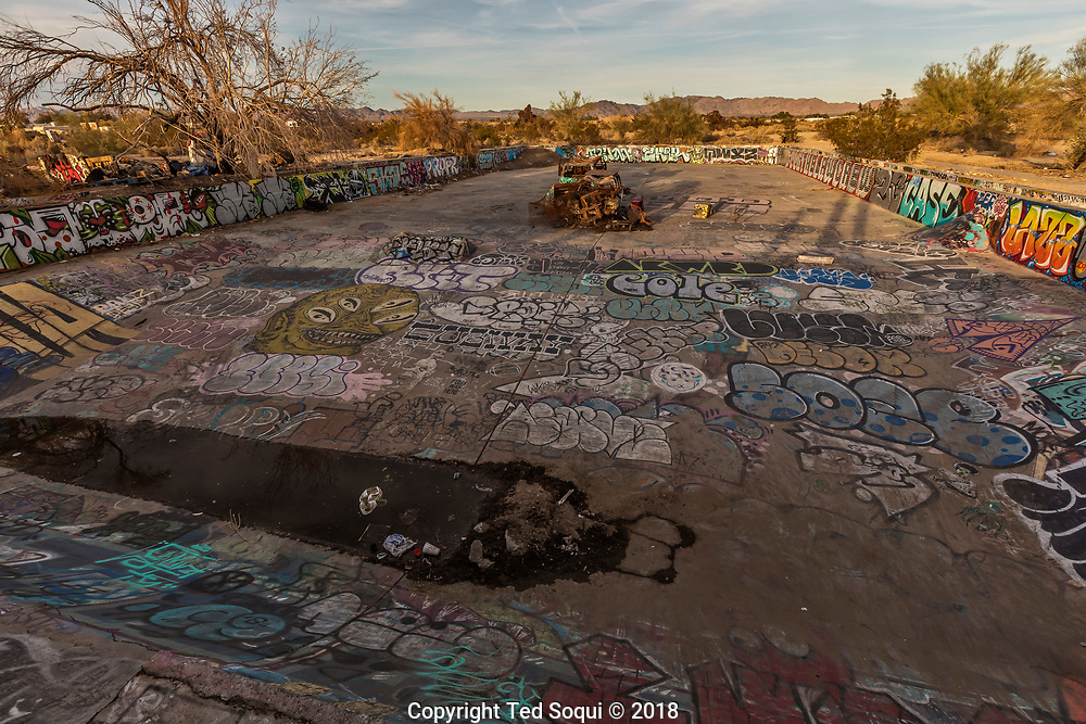 A former pool and now skatepark inside Slab City.<br /> Slab City and the local environs.