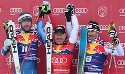 KITZBUHEL AUSTRIA. 22-01-2011. Bode Miller (USA) (L) 2nd Didier Cuche (SUI) (C) Winner and Adrien Theaux (FRA) 3rd at the presentation ceremony for the 71st Hahnenkamm downhill race part of  Audi FIS World Cup races in Kitzbuhel Austria.  Mandatory credit: Mitchell Gunn