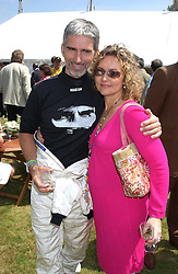 """DAMON & GEORGIE HILL at a luncheon hosted by Cartier at the 2005 Goodwood Festival of Speed on 26th June 2005.  Cartier sponsored the """"Style Et Luxe' for vintage cars on the final day of this annual event at Goodwood House, West Sussex. <br /><br />NON EXCLUSIVE - WORLD RIGHTS"""