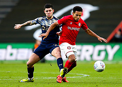 Korey Smith of Bristol City is challenged by Alex Mowatt of Barnsley - Rogan/JMP - 18/01/2020 - Ashton Gate Stadium - Bristol, England - Bristol City v Barnsley - Sky Bet Championship.