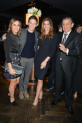 Left to right, JESSICA ENNIS-HILL, EDDIE REDMAYNE, CINDY CRAWFORD and STEPHEN URQUHART at the OMEGA VIP dinner hosted by Cindy Crawford and OMEGA President Mr. Stephen Urquhart held at aqua shard', Level 31, The Shard, 31 St Thomas Street, London, SE1 9RY on 10th December 2014.