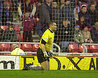 Photo. Glyn Thomas.<br /> Sunderland v Burnley. Nationwide Division 1.<br /> Stadium of Light, Sunderland. 29/11/03.<br /> Burnley's keeper Brian Jensen looks horrified after he failed to stop Kevin Kyle giving the home side a 1-0 lead.