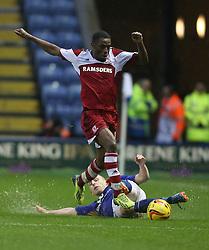 Leicester City's Ritchie De Laet tackles Middlesbrough's Mustapha Carayol - Photo mandatory by-line: Matt Bunn/JMP - Tel: Mobile: 07966 386802 25/01/2014 - SPORT - FOOTBALL - King Power Stadium - Leicester - Leicester City v Middlesbrough - Sky Bet Championship