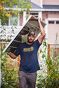 Brion Wickstrom, owner of Synchro Solar, installing panels on a home in Portland, OR. Photographed for Energy Trust of Oregon