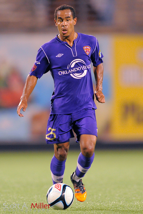 Orlando City Lions forward George Davis IV (25) brings the ball upfield against the Wilmington Hammerheads at the Florida Citrus Bowl on July 25, 2012 in Orlando, Florida. ..©2012 Scott A. Miller