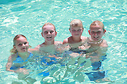 Happy Kids in the Pool on Vacation