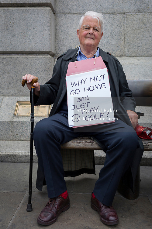 On US President Donald Trump's second day of a controversial three-day state visit to the UK, the veteran CND campaigner Bruce Kent sits among protesters voicing their opposition to the 45th American President, in Trafalgar Square, on 4th June 2019, in London England. Bruce Kent is a British political activist and a former Roman Catholic priest. Active in the Campaign for Nuclear Disarmament, he was the organisation's general secretary from 1980 to 1985 and its chair from 1987 to 1990.