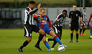 Barry Bannan holding off two men during the Pre-Season Friendly match between Tooting & Mitcham and Crystal Palace at Imperial Fields, Tooting, United Kingdom on 24 July 2015. Photo by Michael Hulf.
