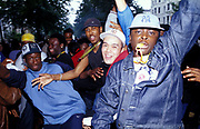 Boys dancing and posing in the street, Notting Hill Carnival 2002