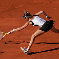 30 May 2009: Maria Jose Martinez Sanchez of Spain stretches for a backhand during the Women's Third Round match on day seven of the French Open at Roland Garros in Paris, France.