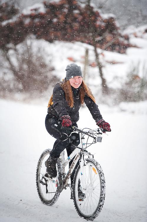 Norwegian exchange student Sunniva Soerheim rides her bike through the snow near Newport Beach during a snowstorm.
