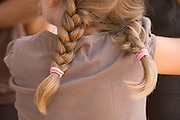young girl with pony tails seen from behind