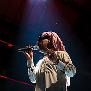 """October 3, 2015 - New York, NY : The performance artist Laurie Anderson collaborated with former Guantánamo detainee, Mohammed el Gharani, in the production of """"Habeas Corpus,"""" an art installation featuring a larger-than-life projection of el Gharani displayed in the Park Avenue Armory drill hall. Here, the Syrian musician Omar Souleyman performs on stage in """"Out of Body,"""" a performance component of the exhibit held in the drill hall on Friday night. CREDIT: Karsten Moran for The New York Times"""