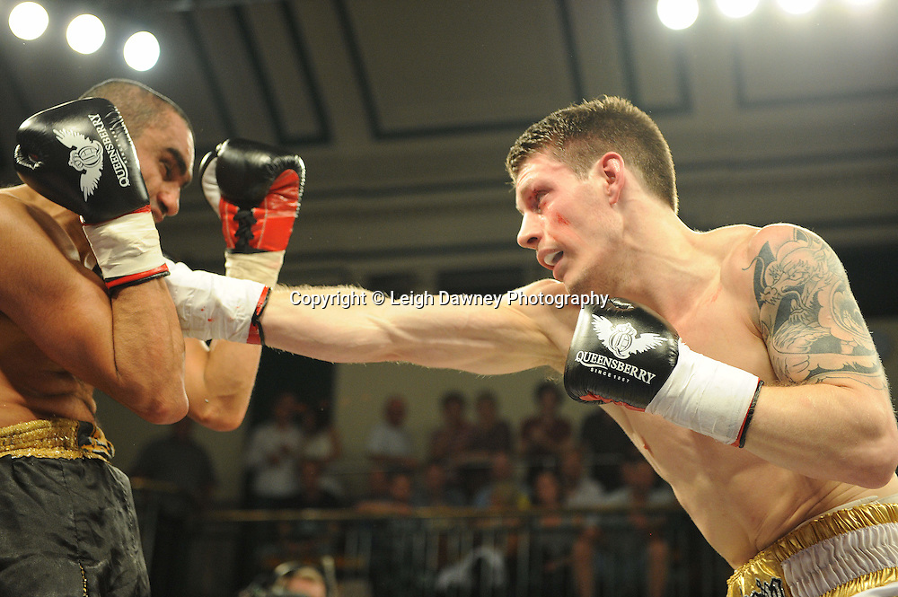Liam Shinkwin (white shorts) defeats Sid Razak at York Hall, Bethnal Green, London on Friday 30th September 2011. Boxnation.tv's debut live TV Channel 456 on Sky. Photo credit: © Leigh Dawney. Queensberry Promotions.