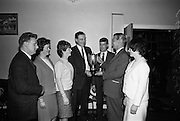 28/4/1966<br /> 4/28/1966<br /> 28 April 1966<br /> <br /> Mr. B. Schoulund handing over the Leo Laboratories Cup to Mr. Wesley Sullivan Secretary of the Business Houses Table Tennis League for the Winners. Cement Ltd Team who won the trophy at the Championships at W.D.O.H.O. Wills on South Circular Rd. <br /> <br /> Included are Mr. M. O'neill;Miss S Lynch, Miss M. Reid; Mr. R. Webb and Miss J. Butterley