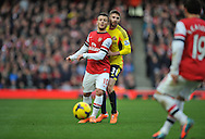 Arsenal's Jack Wilshere holds off Sunderland's Fabio Borini during Barclays Premier League , Arsenal v Sunderland at the Emirates Stadium in London, England on Saturday 22nd Feb 2014.<br /> pic by John Fletcher, Andrew Orchard sports photography.