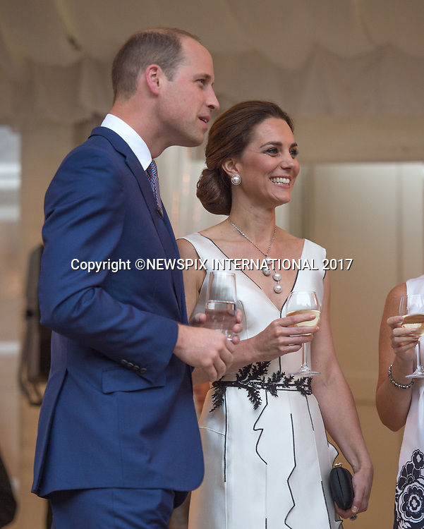 &ldquo;UK 28 Days Out&rdquo;<br /> 17.07.2017; Warsaw, Poland: KATE MIDDLETON AND PRINCE WILLIAM<br /> enjoy a glass of wine when they attended the Queen's Birthday Garden Party at Lazienki Park, Warsaw<br /> Also present at the event was President Andrej Duda and First Lady Anne Duda.<br /> The royals will tour both Poland and Germany over the next five days.<br /> Mandatory Photo Credit: &copy;Francis Dias/NEWSPIX INTERNATIONAL<br /> <br /> IMMEDIATE CONFIRMATION OF USAGE REQUIRED:<br /> Newspix International, 31 Chinnery Hill, Bishop's Stortford, ENGLAND CM23 3PS<br /> Tel:+441279 324672  ; Fax: +441279656877<br /> Mobile:  07775681153<br /> e-mail: info@newspixinternational.co.uk<br /> Usage Implies Acceptance of Our Terms &amp; Conditions<br /> Please refer to usage terms. All Fees Payable To Newspix International