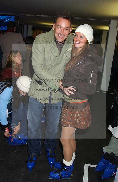 Radio presenter TOBY ANSTIS and STEPHANIE STEWART at the opening of the Natural History Museum's Ice Rink on 16th November 2005.<br />