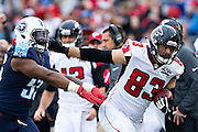 NASHVILLE, TN - OCTOBER 25:  Jacob Tamme #83 of the Atlanta Falcons catches a pass in front of and is pushed out of bounds by Zach Brown #55 of the Tennessee Titans at Nissan Stadium on October 25, 2015 in Nashville, Tennessee.  The Falcons defeated the Titans 10-7.  (Photo by Wesley Hitt/Getty Images) *** Local Caption *** Jacob Tamme; Zach Brown